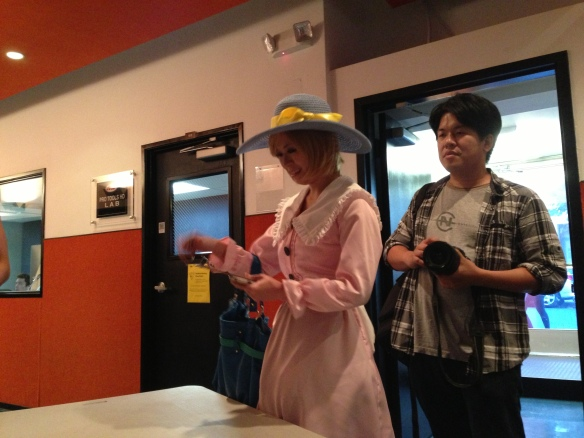 Cosplayers checking in before the show: Qinyou Wang as Flower Girl. Photo credit: K. Clark